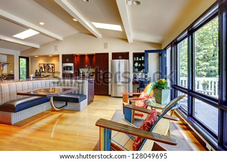 Open modern luxury home interior living room and kitchen.