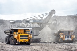Open mountain quarry. Loading coal into a mining truck. Shipment of mountain masyy from the face. Mining in quarry vehicles.