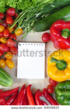 open note book ready with colorful vegetables for writing recipe