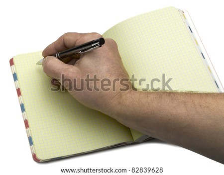 Open note book with crossed lined pages and ballpoint pen