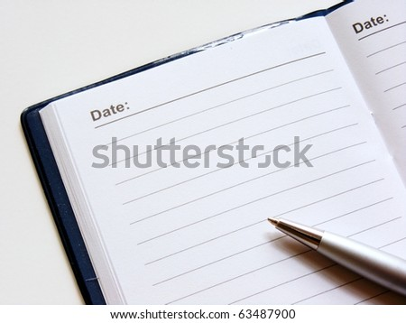 Open note book with lined pages free date space and ballpoint pen
