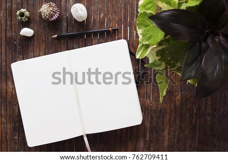 Open notebook flat lay photo. Notepad with blank page top view. Sketchbook spread and tropical decor items on rustic wooden table. Tropical seaside vacation banner template. Summer travel mockup