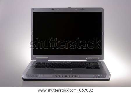 Open notebook laptop computer with wide screen and black keyboard.