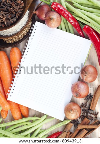 open notebook ready for writing recipe with food ingredients - stock    Open Notebook With Writing