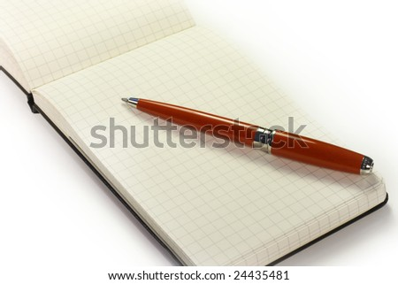 open notebook with a red pen