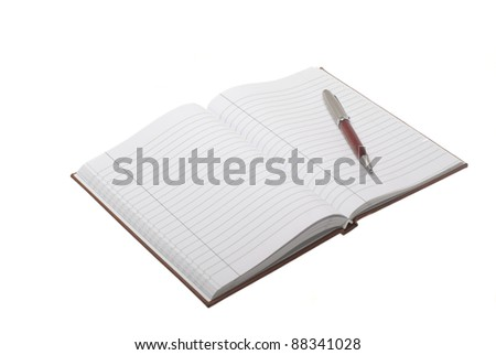 Open notebook with pen on it isolated on white background