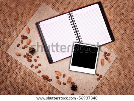 open notebook with picture on background of sacking