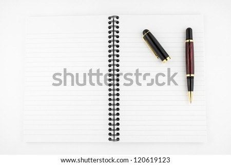 open notebook with  stylish pen isolated on white