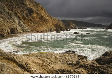 Open ocean and cliffs on the California coast.