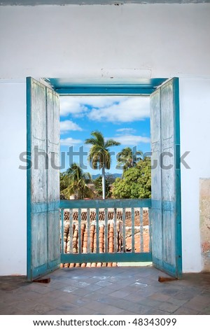 Open old balcony door at colonial house with nice view, Trinidad , cuba