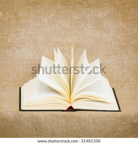 Open old big book on brown canvas background