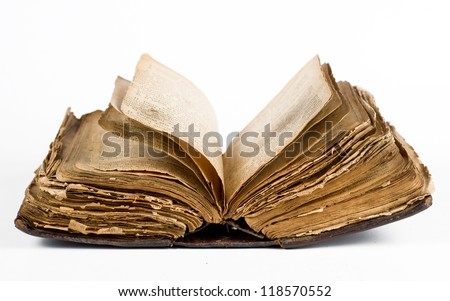 Open old book isolated on white