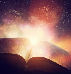Open old book merged with magic galaxy sky, universe, stars. Concept of literature, fantasy, horoscope, religion etc.