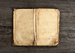 open old vintage book on grungy wooden background