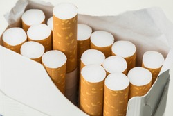 Open pack of cigarettes on white background
