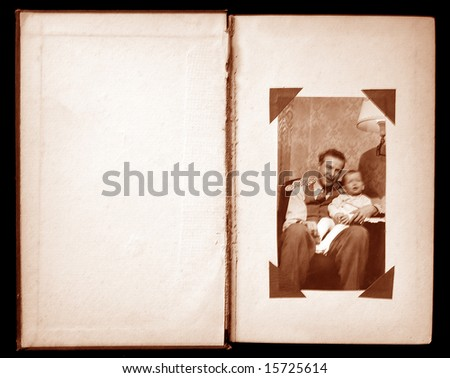 Open page of vintage photo album with old photo