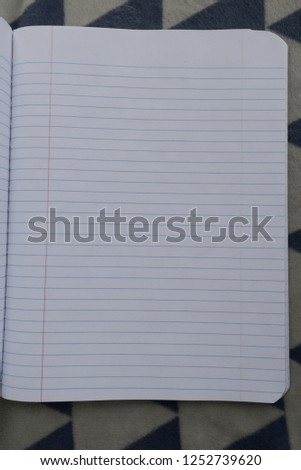 Open page texture with rulers and gridlines from a notebook with a blank piece of paper showing.