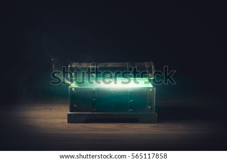 open pandora's box with green smoke on a wooden background /high contrast image #565117858