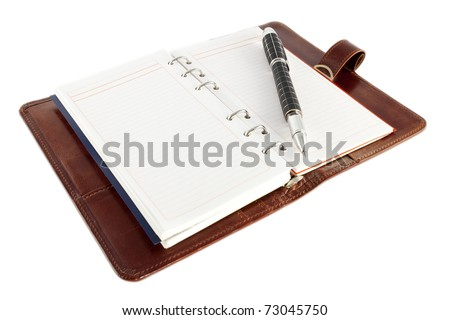 Open personal organizer, with pen, on white background.