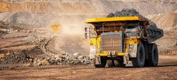 Open pit mine industry, big yellow mining truck for coal anthracite.
