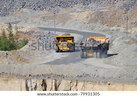 Open-pit mine with dump trucks.