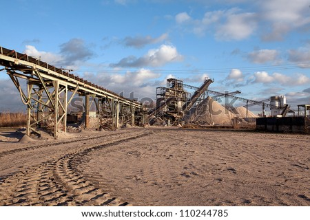 Open pit mining and processing plant for crushed stone, sand and gravel to be used in the roads and construction industry