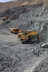 Open pit mining of iron ore and magnetite ores.Loading the iron ore into heavy dump truck at the opencast mining.