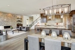 Open plan kitchen equipped with high-end appliances opens to the dining room and the great room with a floor to ceiling stone fireplace. Northwest, USA