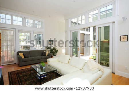 Open plan living room in modern condo apartment