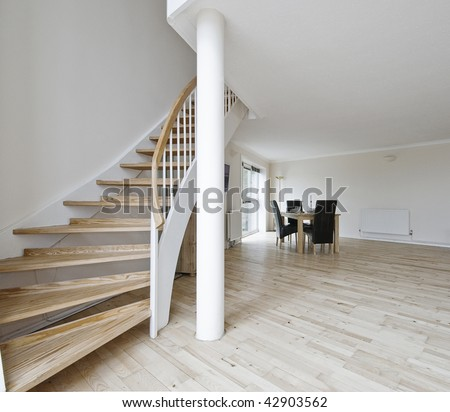 Open Plan Living Room Of A Duplex Apartment With Staircase Stock ...