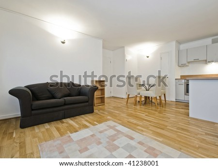 Open plan living room with dining table and kitchen counter stock