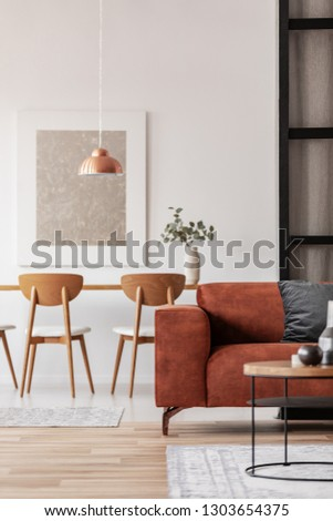 Open plan studio apartment with living and dining area #1303654375