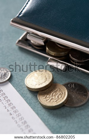 Open purse with till receipt and coins