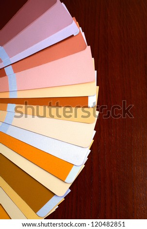 open RAL pantone sample colors catalog on wood background, vertical image