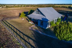 Open Ranch Farm lands large acre lot with Cozy quaint historic Home built in the 1900's in Georgetown , Texas small fence around house with lots of acres of space to expand