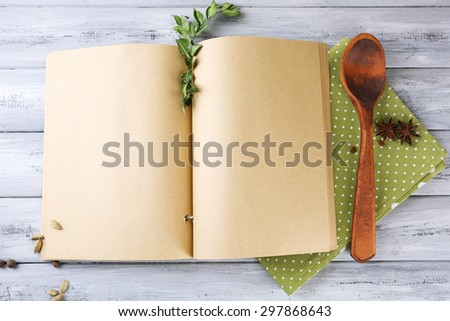 Open recipe book on wooden background