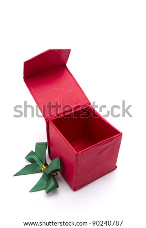 open red box, Red gift box opened wide with green ribbon side.