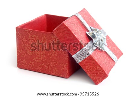 Open red gift box with silver ribbon on white background