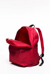 Open red school backpack on white background