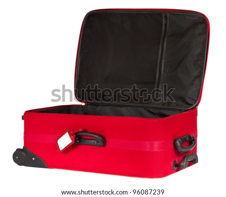 Open red suitcase with blank identification tag isolated over white. - stock photo