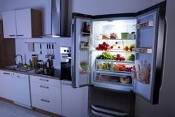 Open Refrigerator Full Of Healthy Items In Modern Kitchen