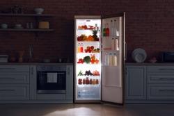 Open refrigerator in dark modern kitchen