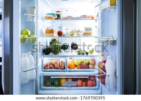 Open Refrigerator Or Fridge Door With Food Inside
