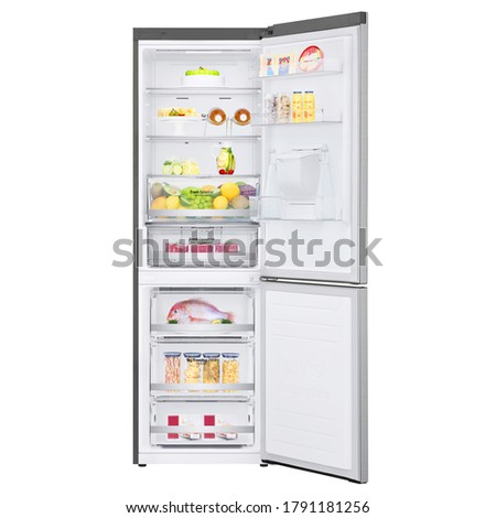Open Refrigerator with Food Isolated on White. Stainless Steel Bottom Mount Fridge Freezer. Two Door Bottom-Freezer Fridge Freezer. Electric Kitchen and  Domestic Major Appliances Front View