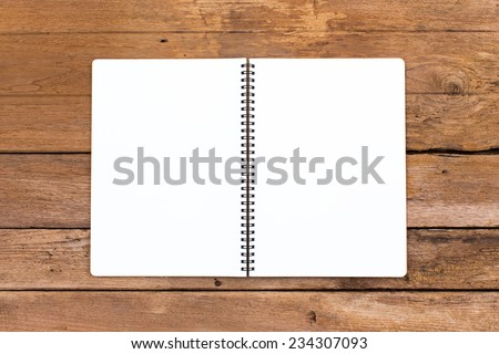 Open ring binder book on wood background #234307093