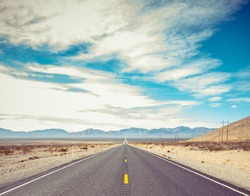 Open Road and possibilities. Road in Death Valley National Park. Artistic Instagram style processing.
