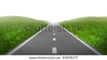 Open road highway with green grass and asphalt street representing the concept of journey to a focused destination resulting in success and happiness.