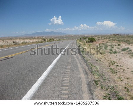 Open road in the high desert of Utah, USA on a bright sunny summer day with few clouds in the sky.  #1486287506