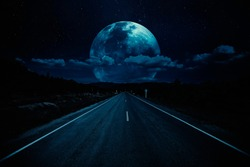 Open road of night sky with clouds and moonlight. Elements of this image furnished by NASA.