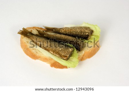 open sandwich with a kipper and leaves of lettuce